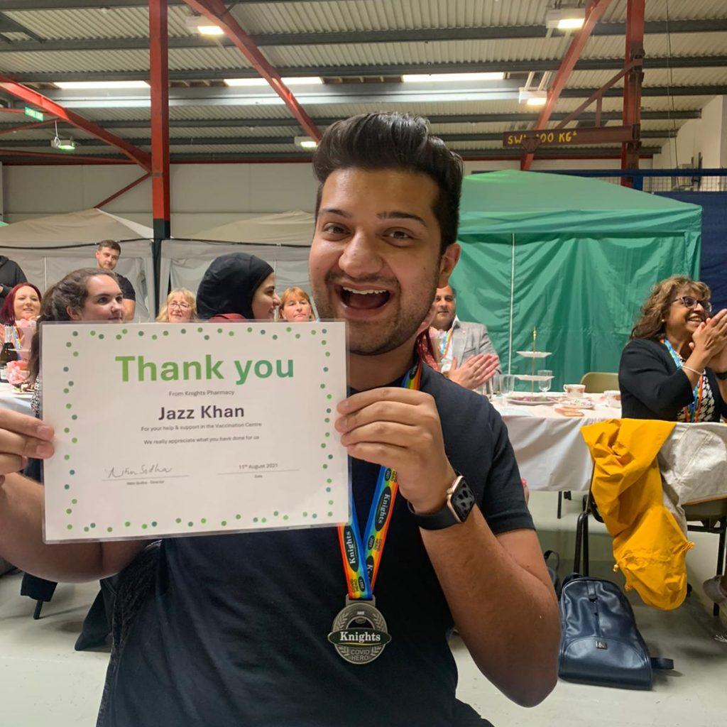 vaccine centre volunteer with certificate